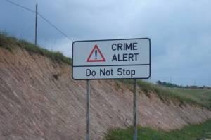 crime-alert-road-sign